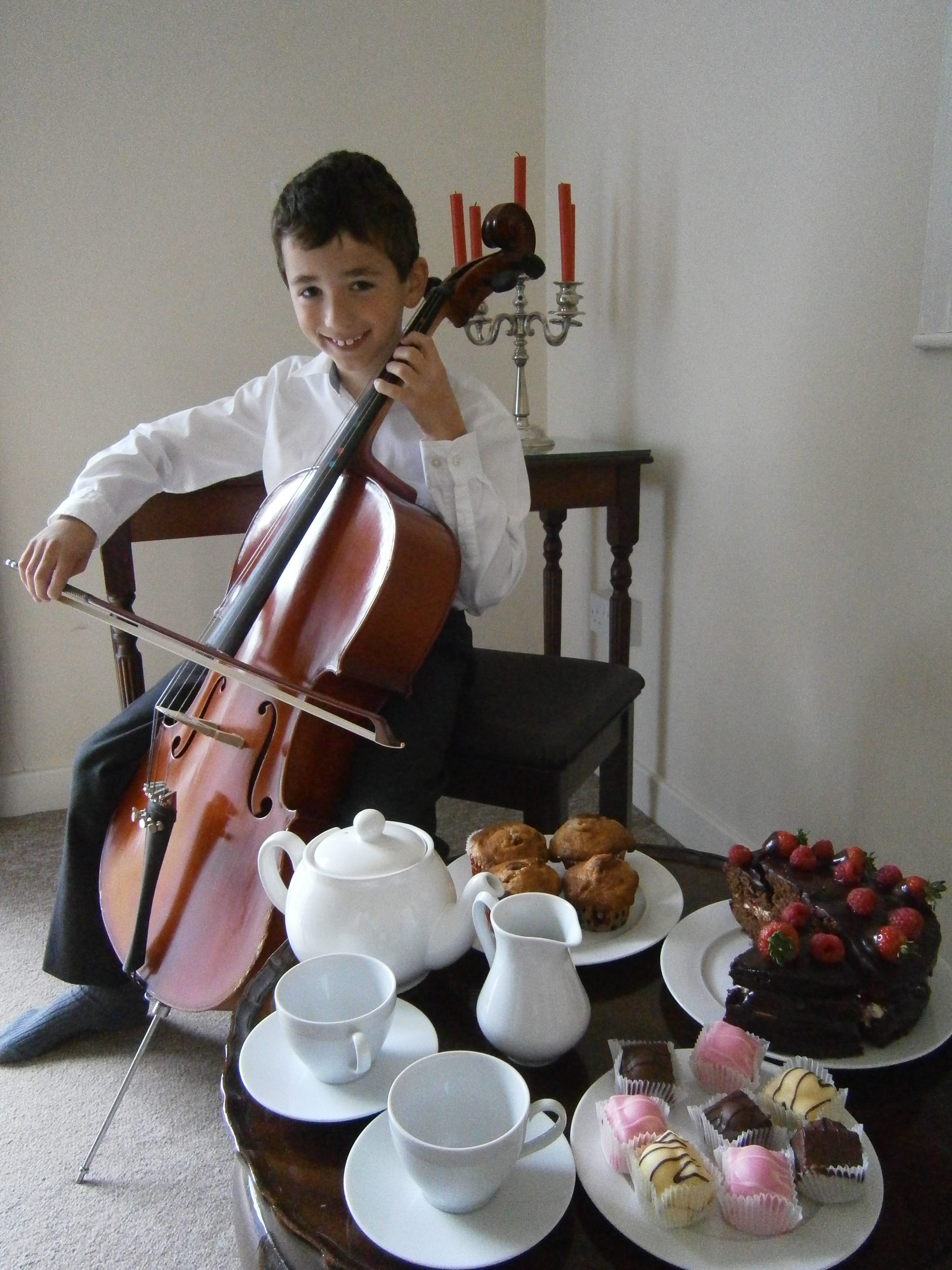 Home Instead Stratford owner's son Robert Maundrill playing the cello for residents at the Waverley Day Centre