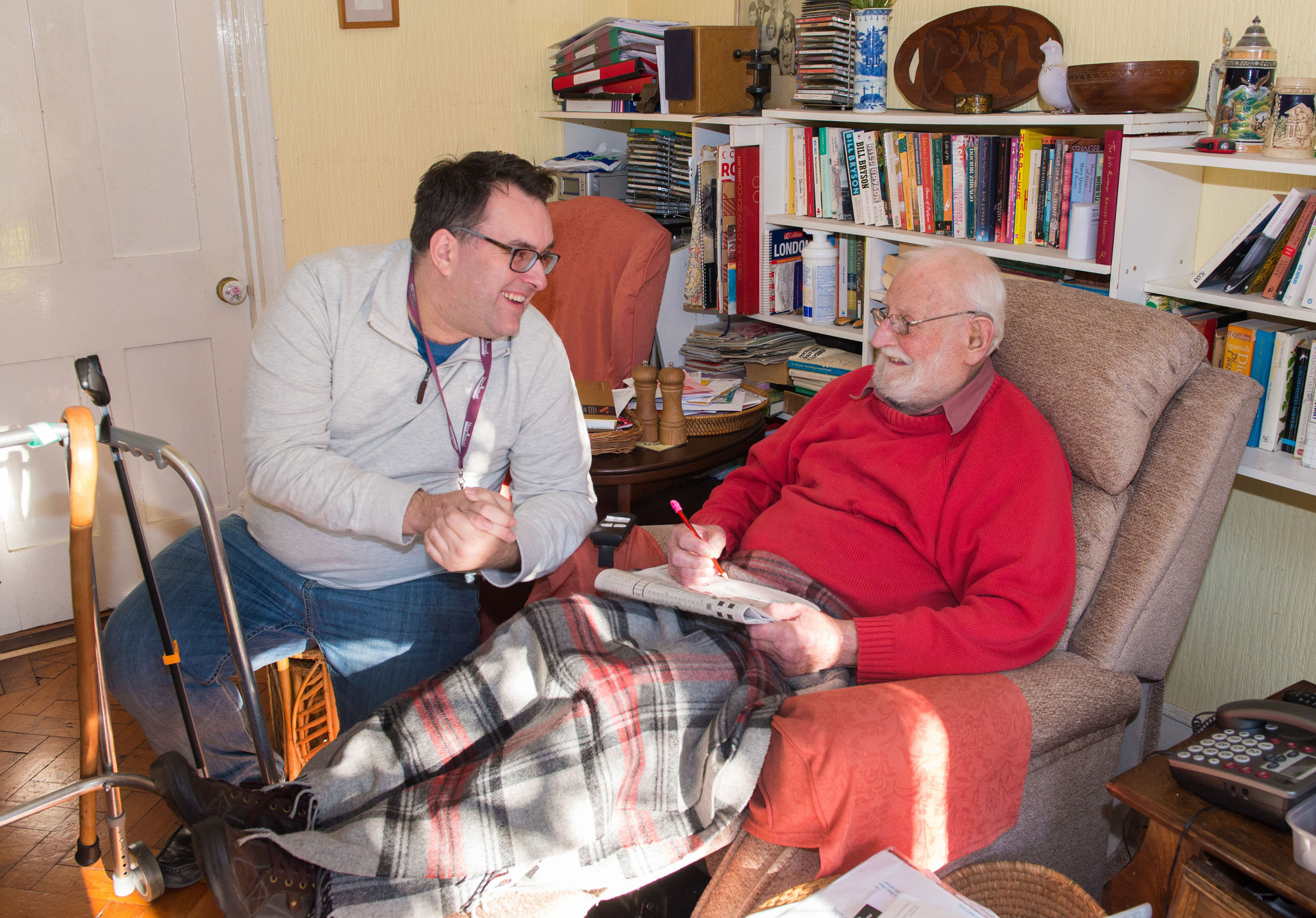Home Instead Cardiff CAREgiver Simon James providing at-home personal care to an elderly client