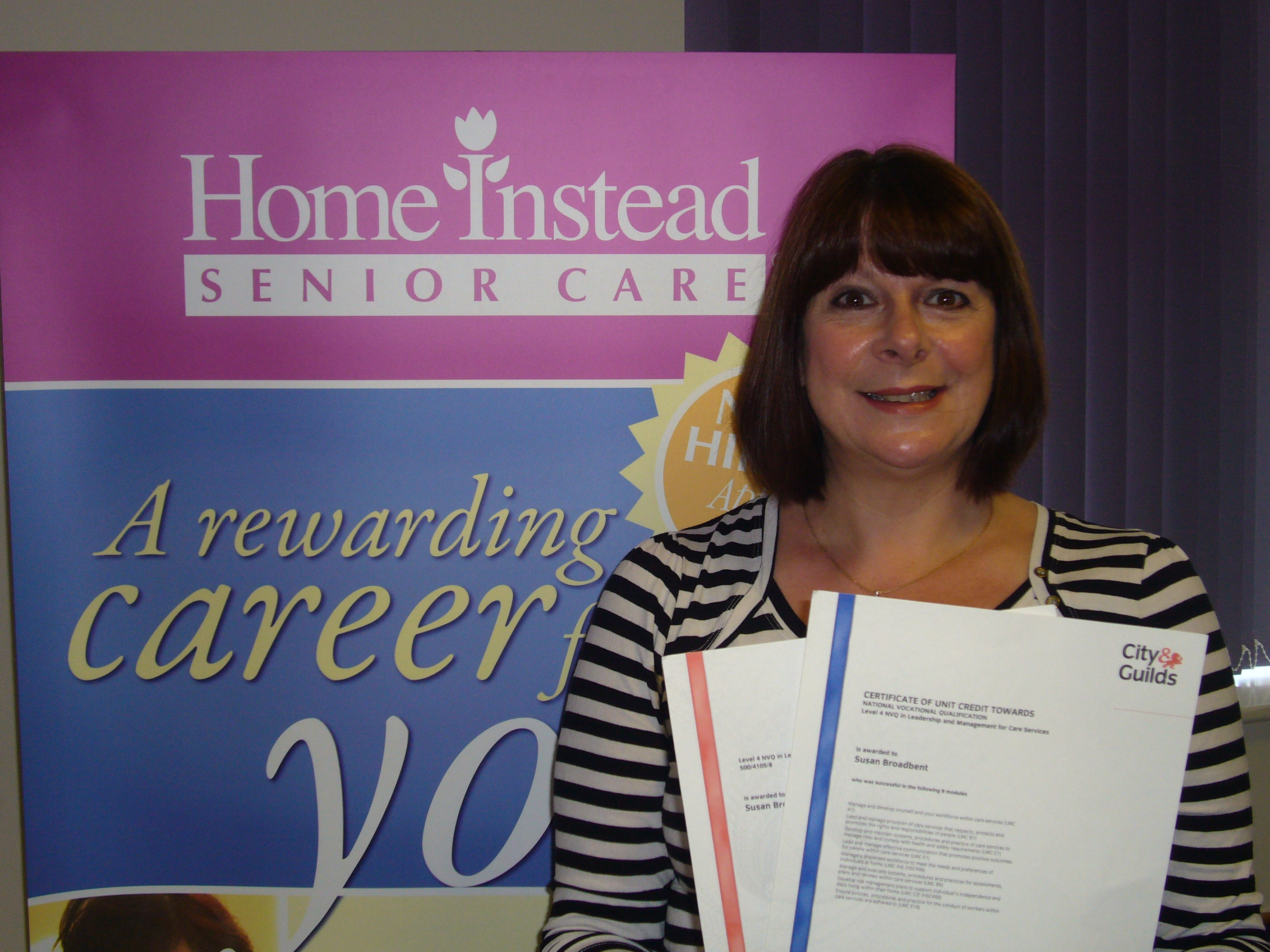 Home Instead Senior Care Chester co-owner and care manager Sue Broadbent with her NVQ 4 in Leadership & Management for Care services certificate
