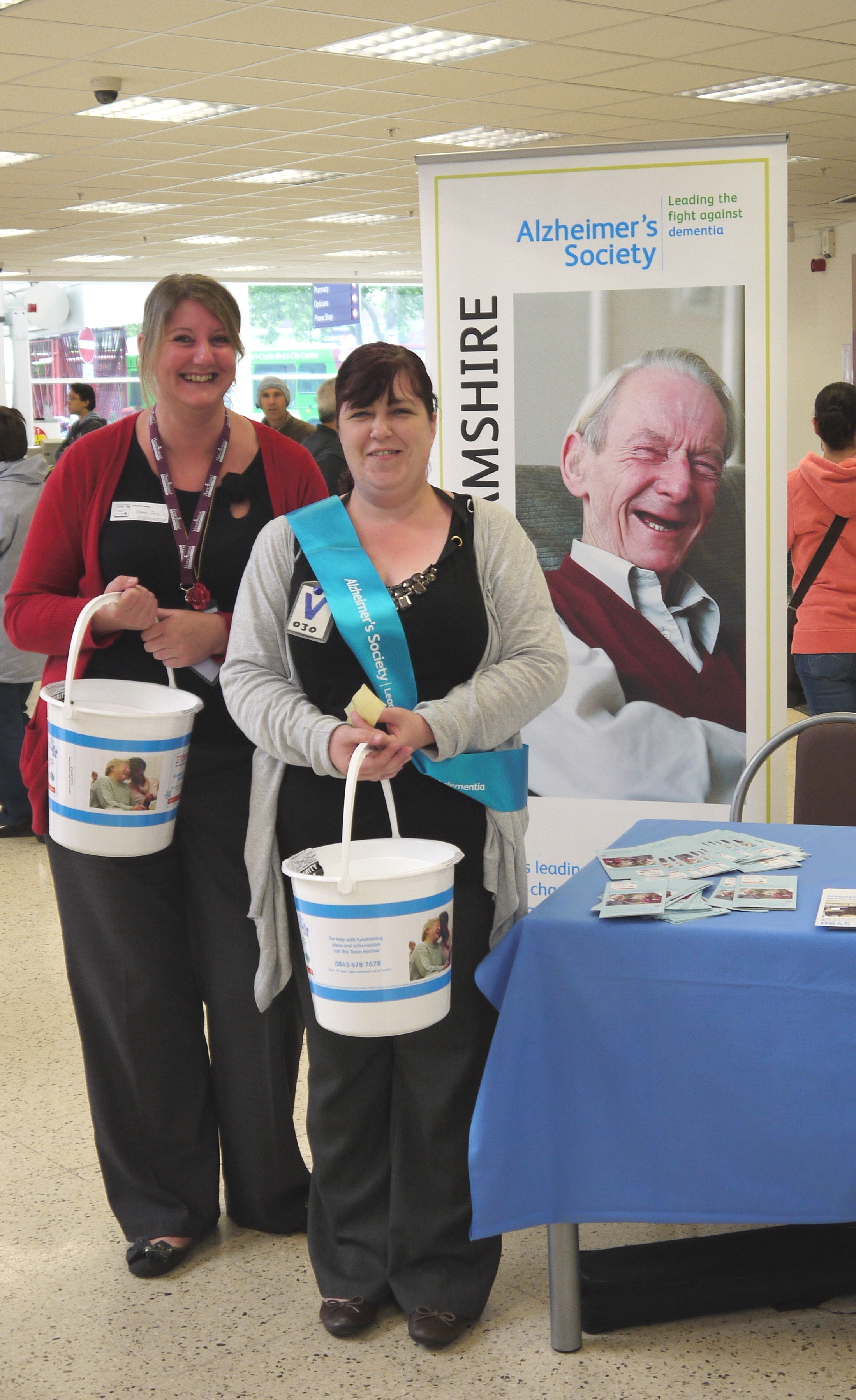 Home Instead Nottingham manager Sarah Gell next to community liaison officer Becky Houghton collecting funds at Tesco supermarket