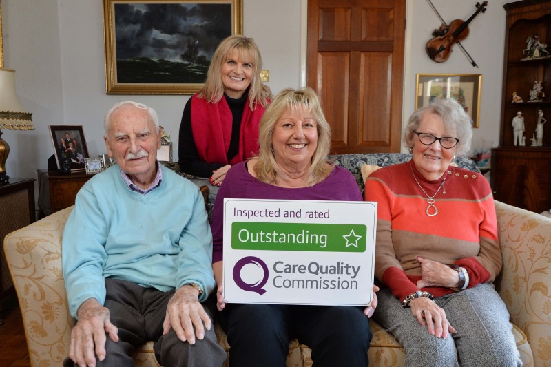 Home Instead Market Harborough, Rutland and Corby owner Gail Devereux-Batchelor holding her CQC Outstanding rating