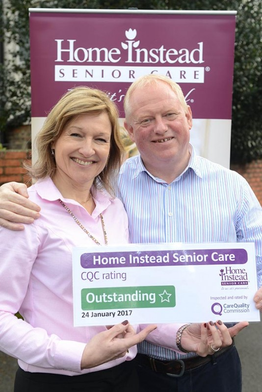 Home Instead Epsom and Mole Valley office owners Paul and Jill Tame holding their CQC Outstanding rating