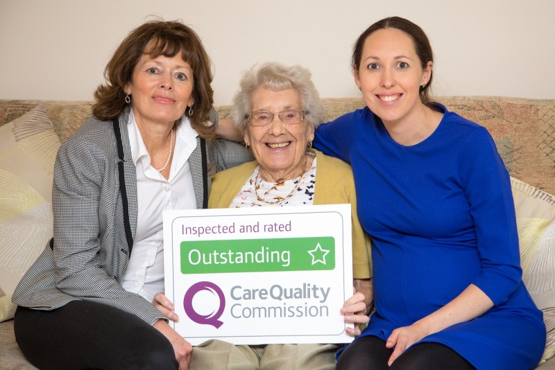 Home Instead Epping Forest team holding their CQC Outstanding rating