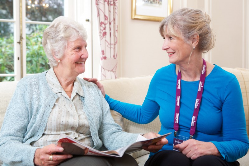 Home Instead CAREgiver providing a home care visit to an elderly client