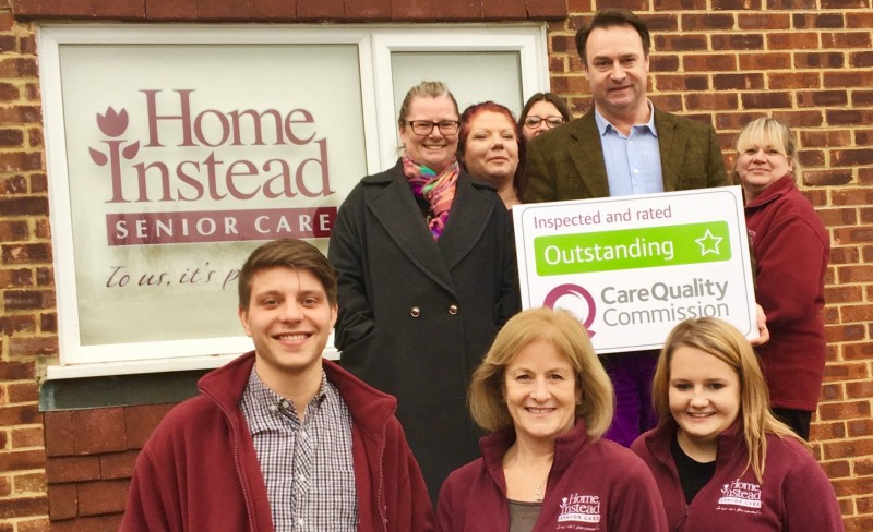 Home Instead Guildford and Woking office team holding their CQC Outstanding rating