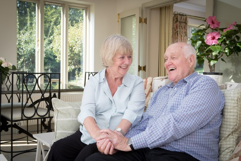 Home Instead CAREgiver providing personal care to a elderly dementia client