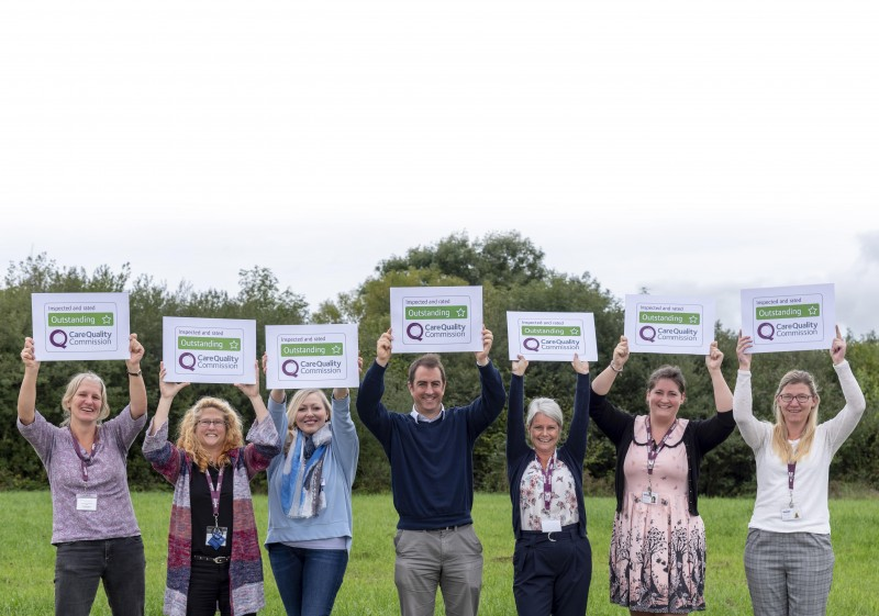 Home Instead North Devon office team holding their Outstanding CQC rating