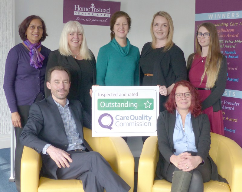 Home Instead Senior Care Bristol North office team holding their CQC Outstanding rating