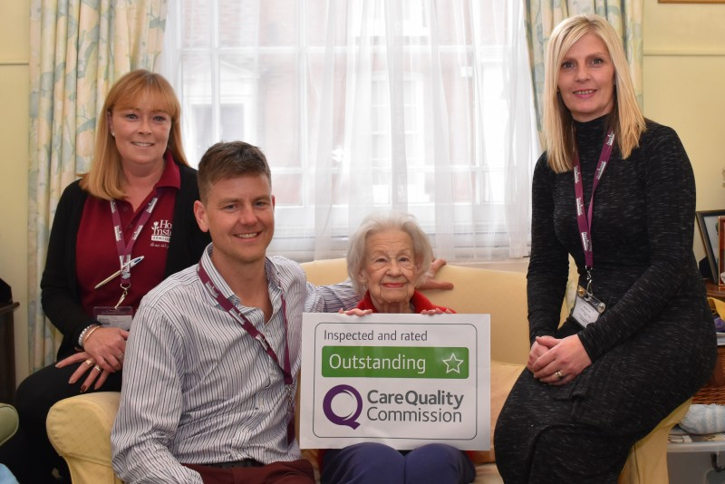 Home Instead Chichester and Bognor Regis team and client holding their rating as Outstanding by the Care Quality Commission