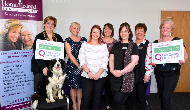 Home Instead Senior Care Durham office team holding their second CQC Outstanding rating