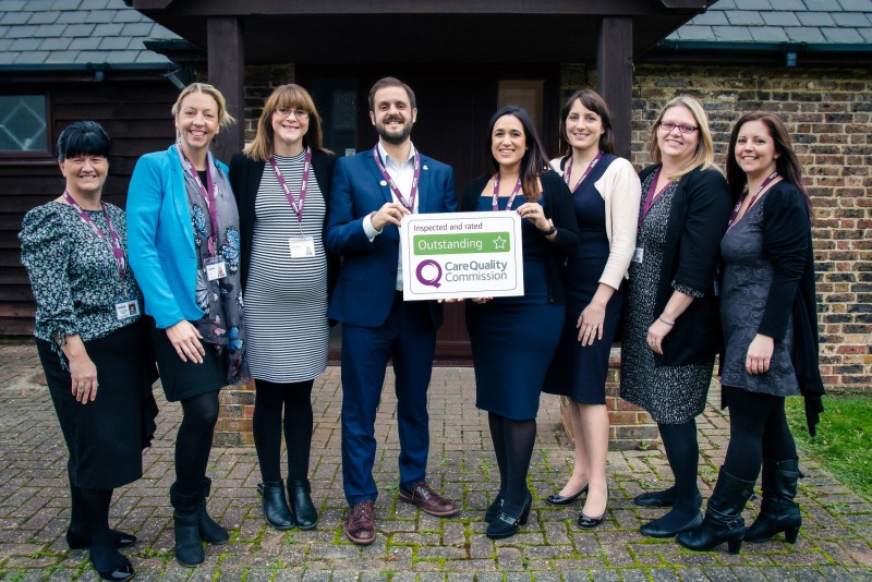 Home Instead Eastbourne & Hailsham office team holding their CQC Outstanding rating