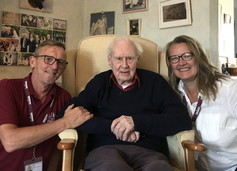 Home Instead CAREgivers Sharon Gregory and Dave Pearce next to their 98-year-old client John Seal