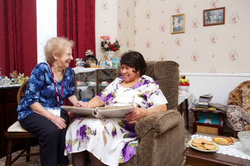 81-year-old Home Instead CAREgiver June Shepherd providing personal home care to an elderly client