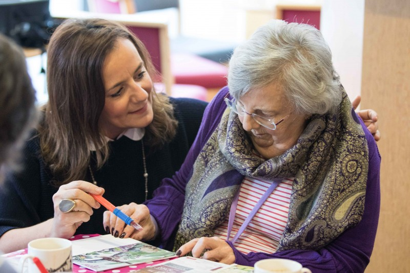 Home Instead Senior Care Wimbledon owner Clare Jefferies providing an elderly client with personal care