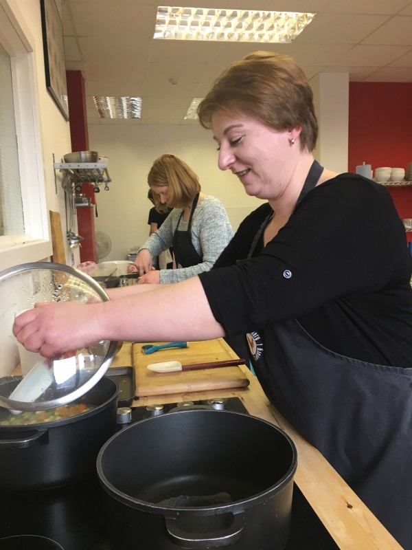 Home Instead Worcester members improving their culinary skills at a 'Senior Supper'