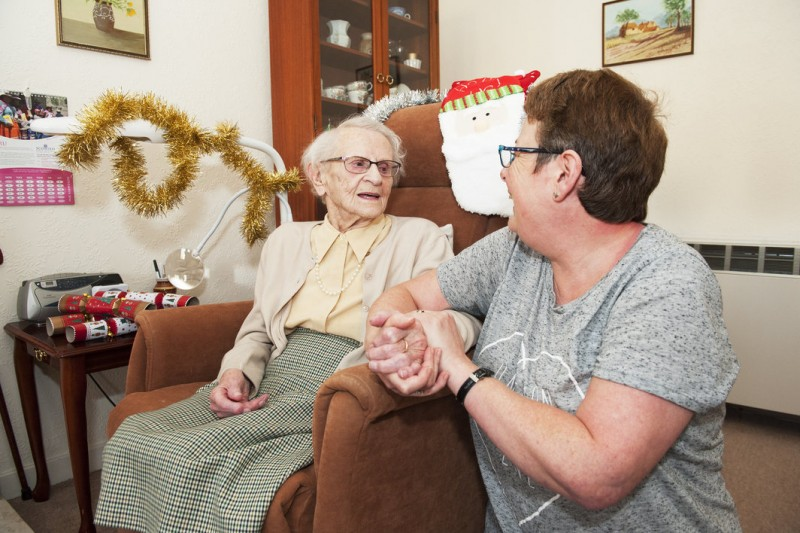 Home Instead CAREGiver from Glasgow North Christine Melville alongside 99-year-old client Helen on Christmas Day