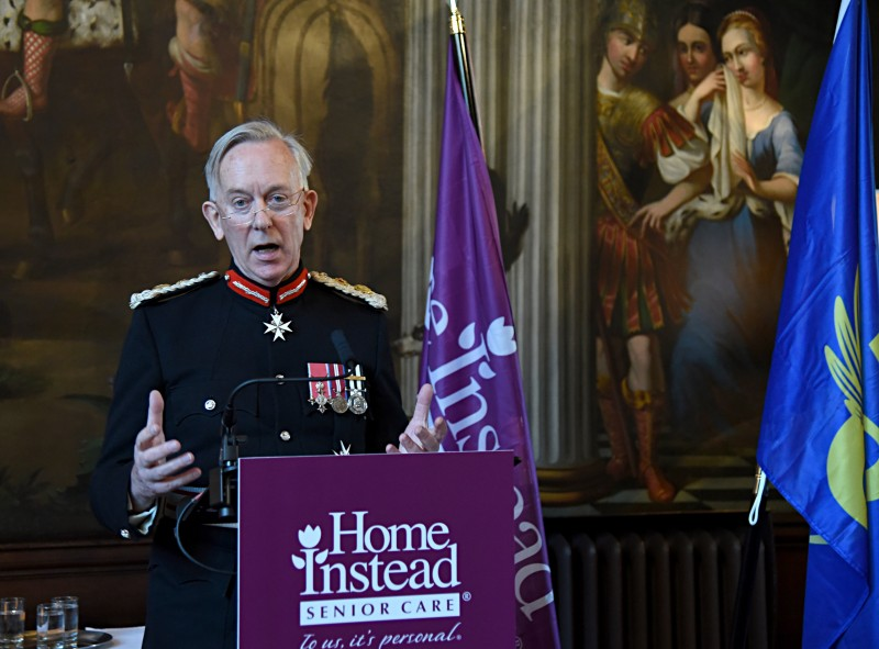Lord Lieutenant David Briggs, MBE, K.St.J., official representative for Cheshire, presenting Home Instead Senior Care with the Queen's Award for Enterprise: Innovation
