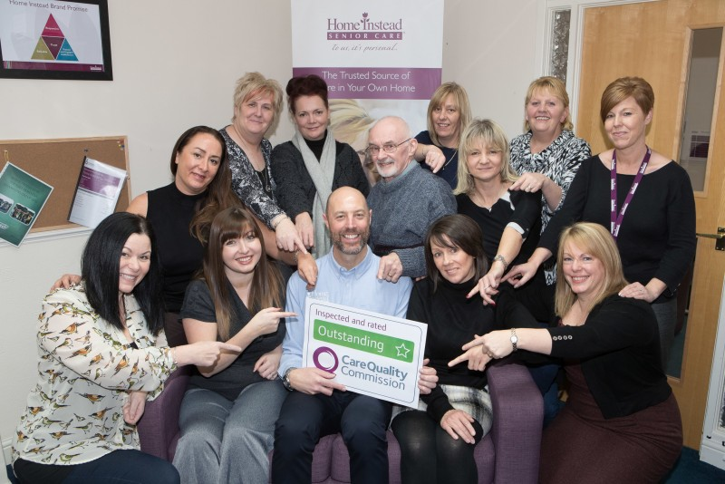 Home Instead Oldham and Saddleworth office team holding their CQC Outstanding rating